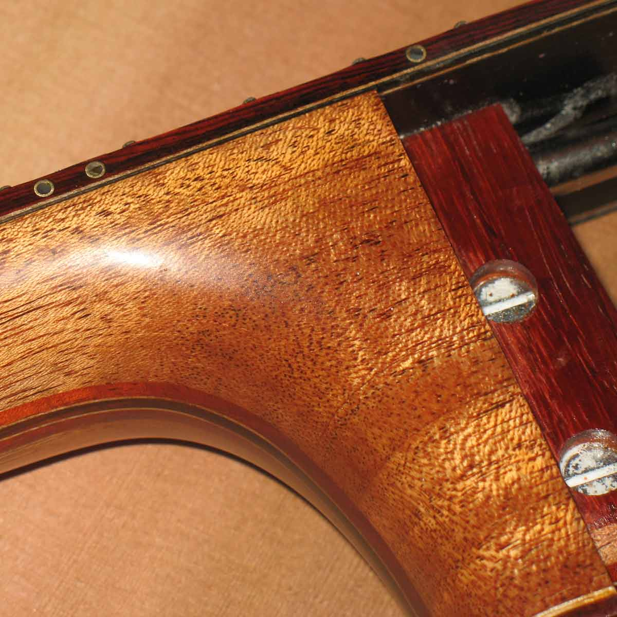 mahogany and cocobolo neck, brass side markers